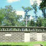 The cemetery has a tomb-like quality--it's a walled-in earthen area built on a small hilltop. The wall was built in 1885 on what archeologists have surmised to be an existing cemetery: bones thought to predate European settlement have been uncovered at this site.