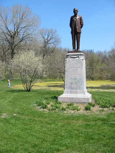 The park's benefactor, Robert Pilcher, is honored with a statue near the nature center.