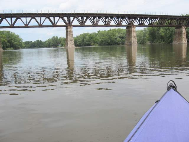 Heading under a railroad bridge south of Elgin